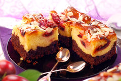 Plum cake with almonds Stock Photo