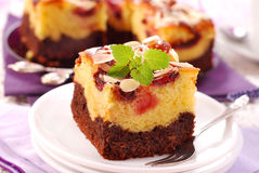 Plum cake with almonds stock photography