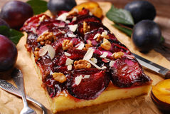 Plum cake with almonds and walnuts Royalty Free Stock Photos