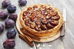 Plum cake with cinnamon and almonds Royalty Free Stock Image