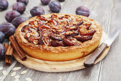Plum cake with cinnamon and almonds Stock Photo