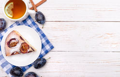 Plum cake with a cup of tea. Stock Photography