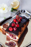 Plum cake food  chocolate cherry close-up still Royalty Free Stock Images
