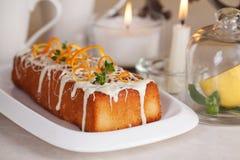 Plum cake food white chocolate, orange zest, thyme, close-up still life with tea and lemon Royalty Free Stock Photo
