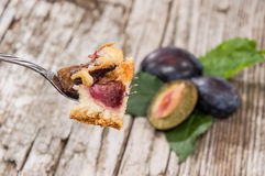 Plum Cake on a fork Stock Images