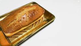 Plum cake. In a golden tray Royalty Free Stock Image