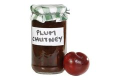 Plum chutney. Jar of home made organic plum chutney isolated on a white background Royalty Free Stock Photos