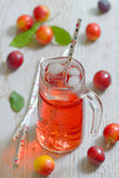 Plum compote in glass jar Royalty Free Stock Image