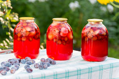 Plum compote home canning in the garden Stock Photo