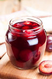Plum compote in jar close up. Stock Images