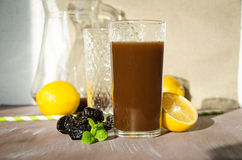 Plum compote with lemon drinking glass Royalty Free Stock Photos