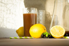Plum compote with lemon drinking glass Royalty Free Stock Images
