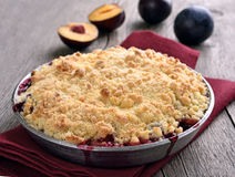 Plum crumb pie. On wooden table royalty free stock photos