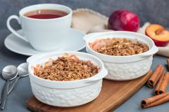 Plum crumble pie or plum crisp with oats and spices, in baking d royalty free stock image