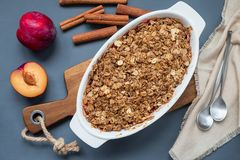 Plum crumble pie or plum crisp with oats and spices, in a baking stock images