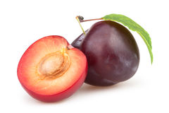 Plum cut half Stock Photos