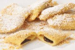 Plum dessert - Zwetschkentasche. Plum dessert with Sugar on white Plate - Zwetschkentasche mit Zucker auf weissem Teller royalty free stock image