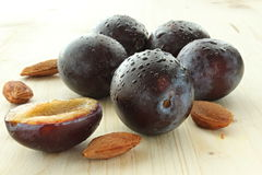 Plum. Detail plum with pips on the wooden board royalty free stock photos