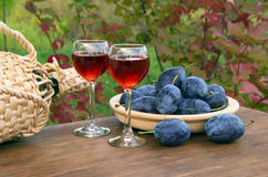 Plum drink in a glass wineglass Royalty Free Stock Photography