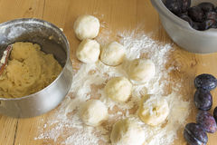 Plum dumplings on the plank table Royalty Free Stock Photo