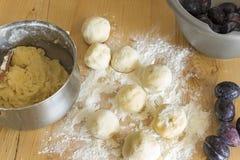 Plum dumplings on the plank table Royalty Free Stock Photo