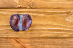 Plum in form of heart Stock Images