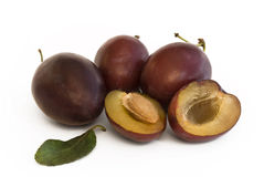Plum fruit with halves Royalty Free Stock Image