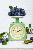 Plum fruit on old vintage scale 1960. One division of 20 grams. Royalty Free Stock Images