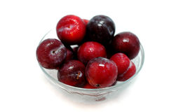 Plum fruits. In the bowl stock photos