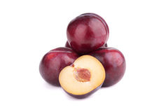 Plum fruits and a half  on white. Background Royalty Free Stock Image