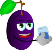 Plum with a glass of water Royalty Free Stock Image