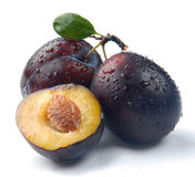 Plum and a half Stock Photo