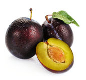 Plum and a half and leaves Royalty Free Stock Photos