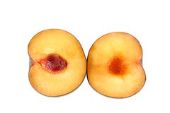 Plum halves. On a white background stock photography