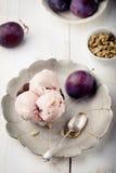 Plum ice cream with cardamon seeds. White background. Royalty Free Stock Image