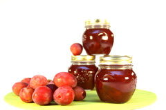 Plum jam. Plum and the jam made of it, isolated stock images