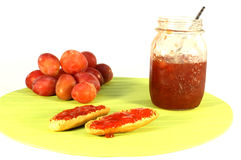 Plum jam. Plum and jams made of it on crust royalty free stock image