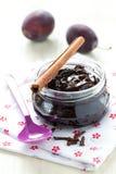 Plum jam. Fresh plum jam in a glass with cinnamon Stock Photo