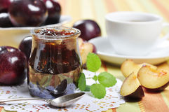 Plum jam. In a glass jar and fresh fruits Stock Images