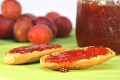 Plum jam. Plum and jams made of it on crust royalty free stock photos