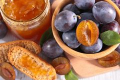 Plum jam and bread Stock Images