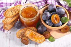 Plum jam and bread Stock Image
