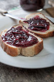 Plum jam with bread Stock Images