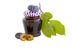 Plum jam with clipping path. A closed glass of plum jam against white. File contains clipping path royalty free stock photos