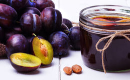 Plum jam in a glass jar. Stock Images