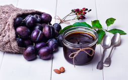 Plum jam in a glass jar. Royalty Free Stock Image