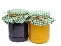 Plum jam and honey in glass jars Stock Photos