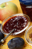 Plum jam and raisins in glass bowl. On table Stock Photography