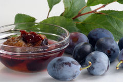 Plum jam and some fresh plums. Homemade plum jam and some fresh plums Stock Photos