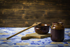 Plum Jam with spoon and bowl Royalty Free Stock Images